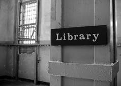 A library sign at a correctional facility.