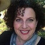 Linda Clemon-Karp wearing a blue scarf and black top