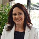 Susan Dziedzic wearing a black top and white blaxer