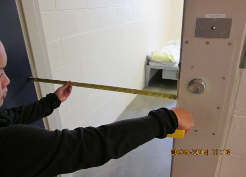 Eva measuring an offender living unit at WCCW